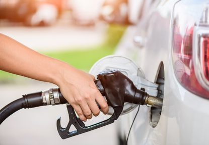 If you keep pumping gas once the nozzle clicks off, you may be forcing liquid into the car's carbon pollution canister. That can cause problems. (Dreamstime/TNS)