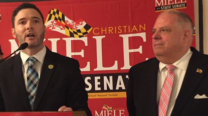 Maryland Del. Christian J. Miele speaks as Gov. Larry Hogan listens at the former's state Senate campaign kickoff event June 8.
