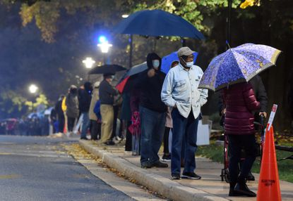 A line of voters on Towson University campus, stretching from the entrance of the polling place to nearly Unitas Stadium, wait for the opportunity to cast their ballot on first day of early voting last year on Monday, Oct. 26. (Brian Krista/Baltimore Sun Media).