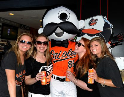 "University of Kentucky students get their picture taken with ""Natty Boh"" at Camden Yards. Despite rumors on social media, Natty Boh will be available at Camden Yards in 2016 at a dedicated location."