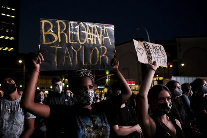 Protesters march following the Breonna Taylor announcement in Brooklyn, Sept. 23, 2020. Anger over Breonna Taylor's killing by police and the prosecutors' handling of the case has spread far from Louisville, with protests on Wednesday night drawing crowds in cities around the nation.
