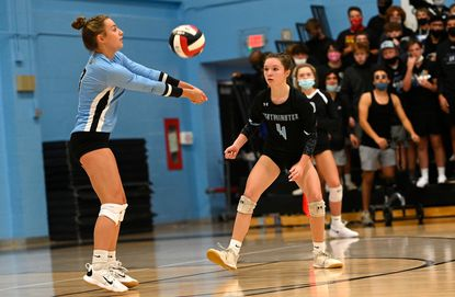 Westminster libero Ellie Yader, left, and the Owls' volleyball team, seen in this photo from earlier this fall, earned a 3-0 victory over Dulaney on Oct. 11.