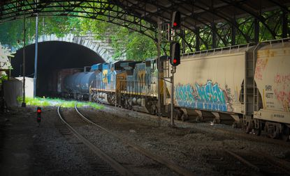 A southbound freight train enters the Howard Street Tunnel at Mount Royal Station. File.