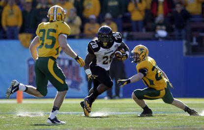 Towson running back Terrance West runs the ball against North Dakota State.