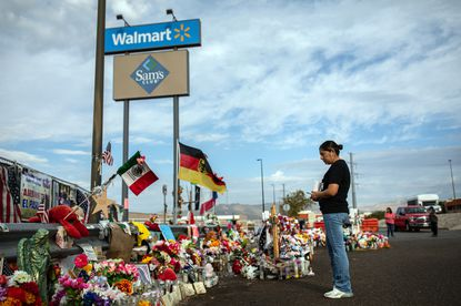 FILE -- Marcela Martínez, whose husband was seriously injured and whose father-in-law was one of 23 killed in a mass shooting at a Walmart, visits a makeshift memorial at the site in El Paso, Texas, Sept. 9, 2019. Hate crimes in the United States rose to their highest level in more than a decade last year, while more murders motivated by hate were recorded in 2019 than ever before, the FBI said on Monday, Nov. 16, 2020. .