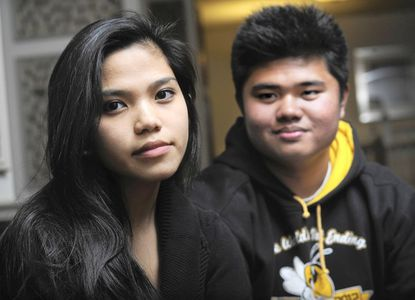 Thea Siozon, 18, left, and Francel Acalain, 18, are seniors at Baltimore Polytechnic Institute.
