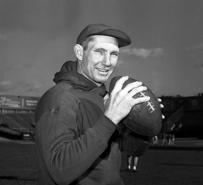 In this Dec. 8, 1961, file photo, New York Giants quarterback Y.A. Tittle works out at Yankee Stadium in New York. Tittle, the Hall of Fame quarterback and 1963 NFL Most Valuable Player, died in 2017. He was 90. (AP Photo/John Lindsay, File)