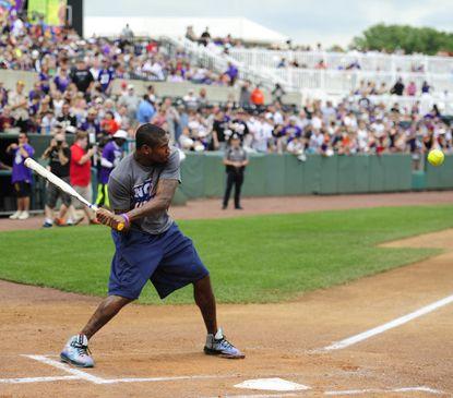 Former Raven Jacoby Jones keeps an eye on the ball and starts his swing during batting practice before the 203Lardarius Webb Charity Softball Game at Ripken Stadium.
