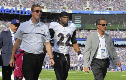 Ravens' Jimmy Smith leaves the field in the second quarter after an injury.