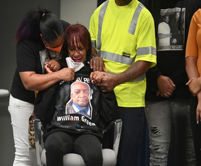 Nicki Owens comforts her aunt Brenda Green during a news conference announcing the family will receive a $20 million settlement in the death of William Green, who was shot by a Prince George's County police officer.