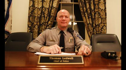 Westminster Police Chief Thomas Ledwell poses for a portrait at his post on the city staff desk at the Westminster Mayor and Common Council Meeting Monday, March 11, 2019.