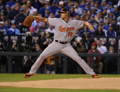 Orioles left-hander Wei-Yin Chen pitches in the first inning of Game 3 of the American League Championship Series against the Kansas City Royals at Kauffman Stadium.