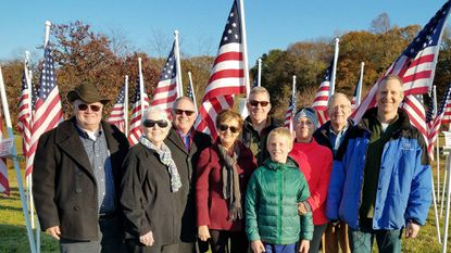 Three generations of Col. Robert Kane's family attended the Veterans Day and Flags for Heroes ceremony, they are Robert Kane Jr. (left to right), Judith Kane Parker, Richard Kane, Mary Kane, Scott Parker, Coleman Kane Parker, Regina Parker, Bob Parker and Robert Todd Parker.
