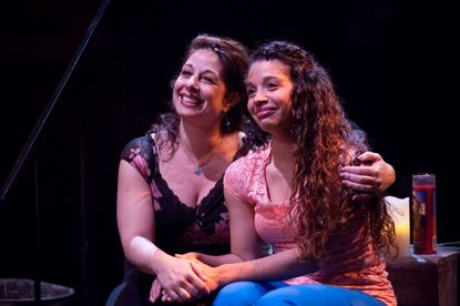 "Camila (Tina DeSimone) and Nina (Alyssa V. Gomez) share a mont in the Toby's Dinner Theatre production of ""In the Heights."""
