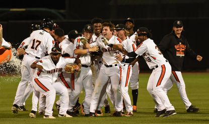 Aberdeen's Andrew Daschback is held by teammates as another approaches with a water cooler to douse him, in celebration of his walk-off hit in the bottom of the 9th inning to defeat Brooklyn 5-4 during the IronBirds final home game of the 2019 regular season at Ripken Stadium.