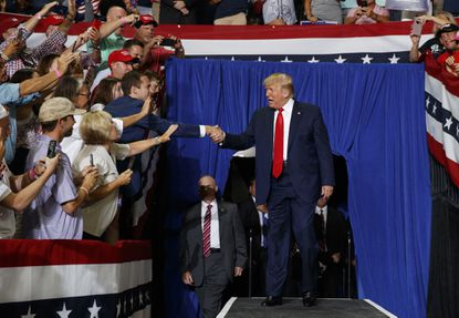 President Trump arrives at a campaign rally Wednesday in Greenville, N.C.