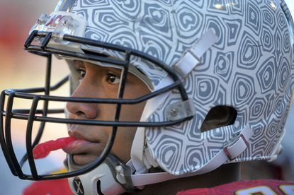 The expression of Maryland Terrapins defensive lineman A.J. Francis, beneath the snazzy patterned new team helmet shows a sense of frustration in the season as The Virginia Cavaliers put it to the Terps in the fourth quarter of the final home game of the season at Byrd Stadium, Nov. 5, 2011.