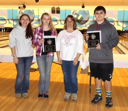 League members pictured are High Average Champions, Matt Wassin (right) from Aberdeen and Katelyn Eckart from Bel Air, holding their plaques, along with volunteers Samantha Schnur, a 4-year alumna of the League, and Kim Rynes, mother of two of this year's league bowlers at the award ceremony.