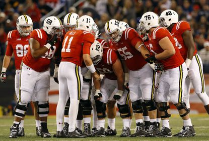 Maryland quarterback Perry Hills (11) huddles with teammates in the second half of an NCAA college football game against Penn State, Saturday, Oct. 24, 2015, in Baltimore.