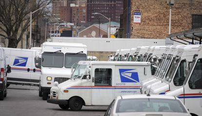 Vehicles navigate the downtown delivery annex parking lot at Baltimore's main U.S. Postal Service location.