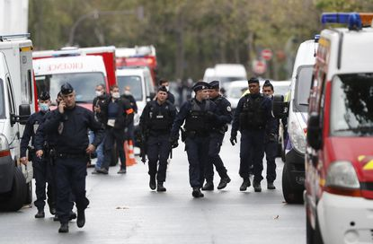 French police officers patrol after four people were wounded in a knife attack near the former offices of satirical newspaper Charlie Hebdo on Sept. 25, 2020 in Paris.