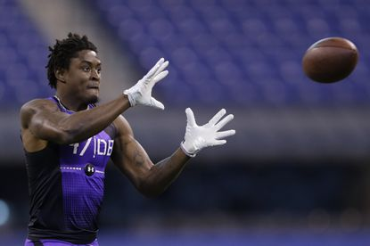 Towson defensive back Tye Smith runs a drill at the NFL football scouting combine in Indianapolis.