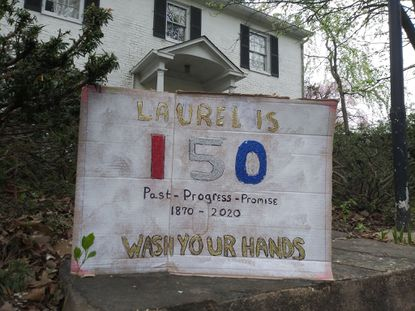Laurel residents who hung 150th anniversary signs in their windows on April 4 will save them and donate them to the museum when it reopens.