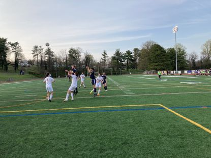 Catonsville senior Matt Lauer, center, and Hereford's Ralphie Kruger await a corner kick in the game that ended in a 1-1 tie. Lauer, one of two Comets honored on senior night, scored Catonsville's only goal.