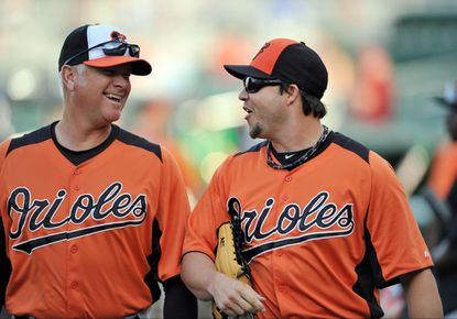 Jim Presley (left) talks with Steve Pearce before a game last spring.