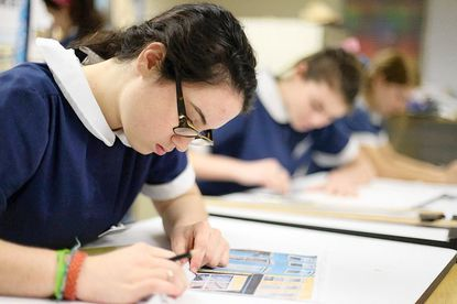 Meghan Cain, left, 15, of Homeland works on an art project during basic studio class at Notre Dame Prep in Towson on Friday, Feb. 24.