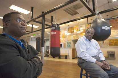 Elmer Johnson, left, and Charles Fleming reminisce about boxing trainer Mack Lewis at his gym.