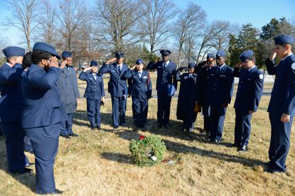 Laurel High School Junior ROTC Air Force members salute a veterans grave at Ivy Hill Cemetery in 2018.