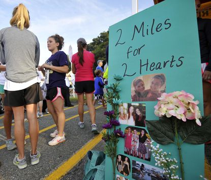 About 600 people take part in the 2 Miles for 2 Hearts Memorial Run to honor the lives of 19-year-olds Rose Mayr and Elizabeth Nass. The friends died in a train derailment last summer.