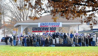 """Cast members stand and cheer for a campaign rally scene in """"House of Cards"""" filmed Thursday afternoon at Festival Park in Aberdeen."""