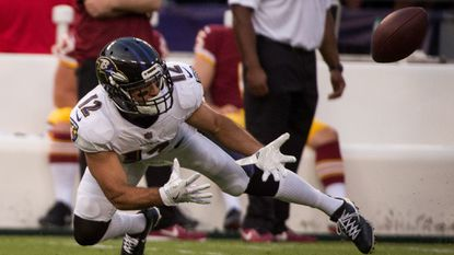Ravens wide receiver Michael Campanaro reaches to catch a ball in the first quarter of the preseason game against the Washington Redskins at M&T Bank Stadium.
