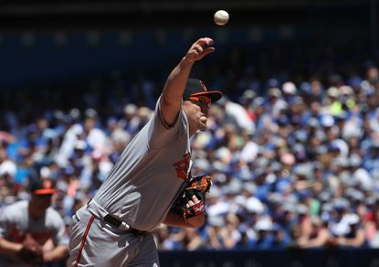 Orioles' Vance Worley delivers a pitch in the first inning against the Toronto Blue Jays on June 12, 2016 at Rogers Centre in Toronto, Ontario, Canada.