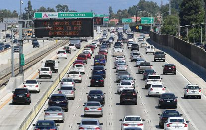 Traffic flows east on the Interstate 10 freeway down FasTrak express lanes and regular lanes in Los Angeles last week as President Donald Trump announced that his administration is revoking California's authority to set its own stricter emissions standards.