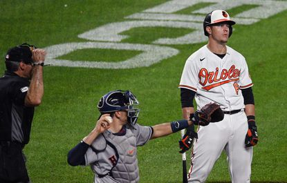 Orioles' Ryan Mountcastle, right, reacts in frustration as homeplate umpire Angel , left, calls a second strikes on him in the seventh inning. Mountcastle eventually flied out during the at bat.