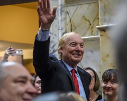 Maryland Comptroller Peter Franchot waves while in the House of Delegates chamber on the opening day of the 2019 General Assembly session.