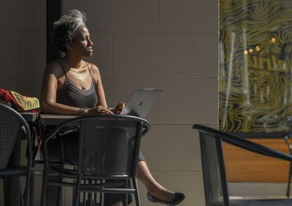 Pamela Woolford, a Howard County-raised artist, is working on a book, part memoir and part appendix of influential black people who have lived in Columbia. She often writes in cafes downtown, within walking distance of her home.