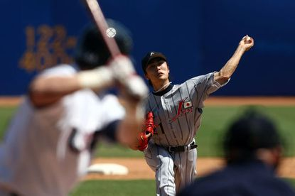 """Tsuyoshi Wada pitches for Japan against the U.S. in the bronze medal game of the 2008 <runtime:topic id=""""EVSPR00000713475"""">Olympics</runtime:topic>."""