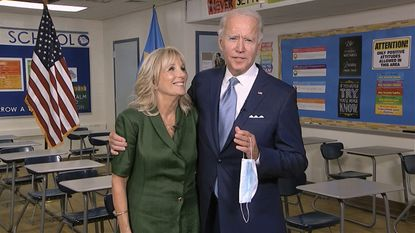 In this image from video, Jill Biden is joined by her husband, Democratic presidential candidate former Vice President Joe Biden, after speaking during the second night of the Democratic National Convention on Tuesday.