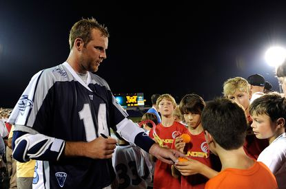 Drew Westervelt signs autographs after the Chesapeake Bayhawks defeat the Boston Cannons during a game at Navy-Marine Corps Memorial Stadium on July 18, 2013, in Annapolis.