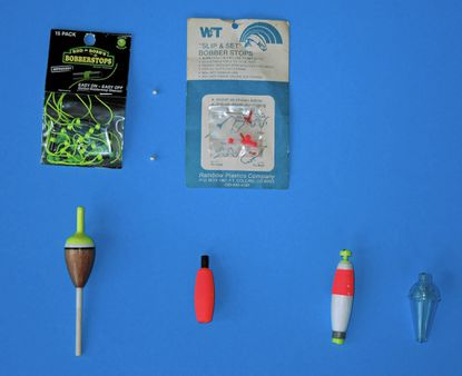 A collection of floats: Top: Left: String type bobber stops and beads, Right: Plastic bobber stops and beads. (Instructions are on the packages.) Second row: Left: Two slip floats, Right: Weighted clip-on float, clear clip-on float.