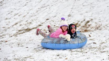 Alayna and Bryce Ewing have some fun sledding down the hill at Tydings Park in Havre de Grace Wednesday afternoon after school was cancelled because of snow or ice for the third time in three weeks. The end of the school year in Harford County has been pushed back to June 12.