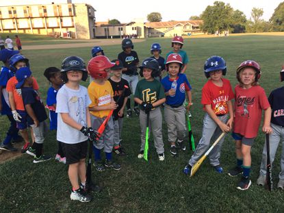 Campers pose during a break at the baseball clinic featuring former Major League players held at the Weltmer Bowl in Catonsville.