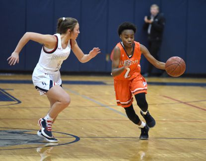 Fallston's Chantel Curry turns on the speed and sprints up the court past Bel Air's Emma Sanza during a game last season.