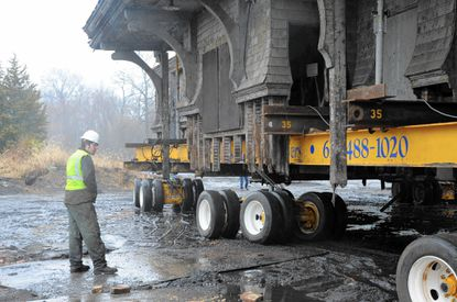 A worker with Wolfe House & Building Movers, of Pennslyvania, watches as the historic B&O Railroad passenger station in Aberdeen is moved away from the CSX tracks Tuesday.