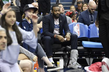 The Washington Wizards' John Wall (2) sits on the bench during a timeout in the second half against the Boston Celtics, Tuesday, April 9, 2019, in Washington. The Celtics won, 116-110.