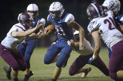 FSK running back Ryan Rill runs into the end zone to score one of his two touchdowns in the first half of the Eagles' game against the Falcons in Uniontown Friday, Sept. 20, 2019.